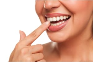 woman pointing to straight teeth