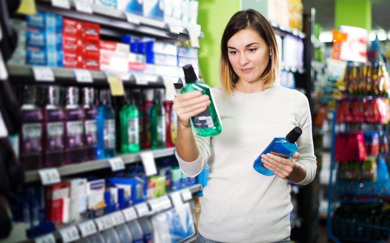 woman-comparing-ingredients-of-mouthwash-Bradford-Dentist