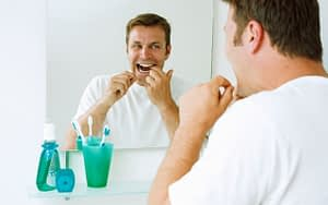 add-flossing-to-daily-routine-smart-oral-health-goals-for-2021-Bradford-Dentist